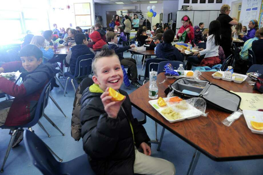 Brennan Campbell, 7, said that the new lunch was very good at  North Mianus School, at Mianus, Conn., Thursday, March 14, 2013. Children and their parents were invited into the North Mianus School cafeteria to sample food from the new Healthy Hawks lunch pilot program. Photo: Helen Neafsey / Greenwich Time