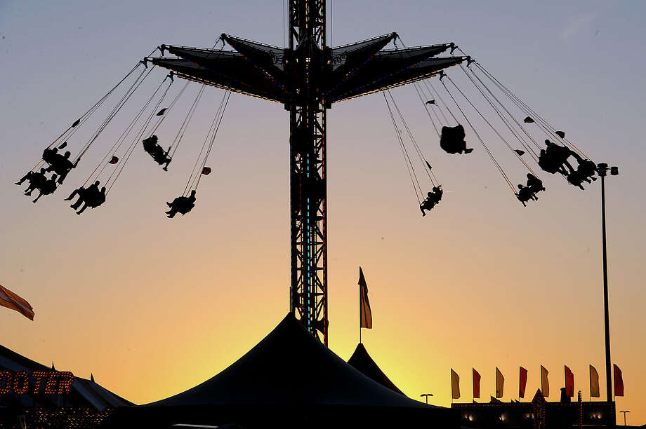 Fans ride the Super Shot at the South Texas State Fair during Thursday's opening day.  Photo taken Thursday, March 22, 2012 Guiseppe Barranco/The Enterprise Photo: Guiseppe Barranco, STAFF PHOTOGRAPHER / The Beaumont Enterprise