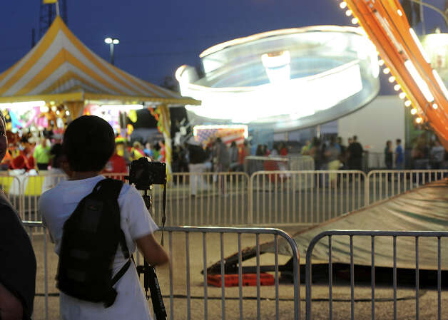 Several photo fans were spotted taking pictures at the South Texas State Fair on Thursday.  Photo taken Thursday, March 22, 2012 Guiseppe Barranco/The Enterprise Photo: Guiseppe Barranco, STAFF PHOTOGRAPHER / The Beaumont Enterprise