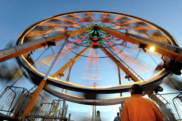 Fans ride the Ferris Wheel at the South Texas State Fair during Thursday's opening day.  Photo taken Thursday, March 22, 2012 Guiseppe Barranco/The Enterprise Photo: Guiseppe Barranco, STAFF PHOTOGRAPHER / The Beaumont Enterprise