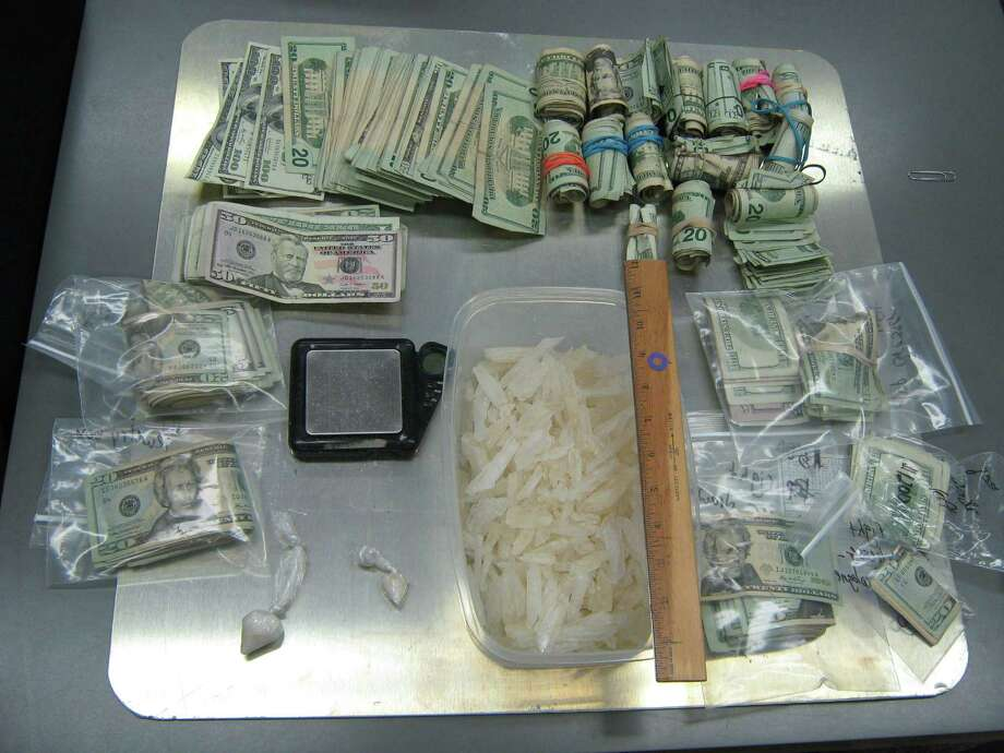 Meth and cash seized during a search at a home in Willis about 9:30 a.m. Tuesday March 19. Photo: Mcso