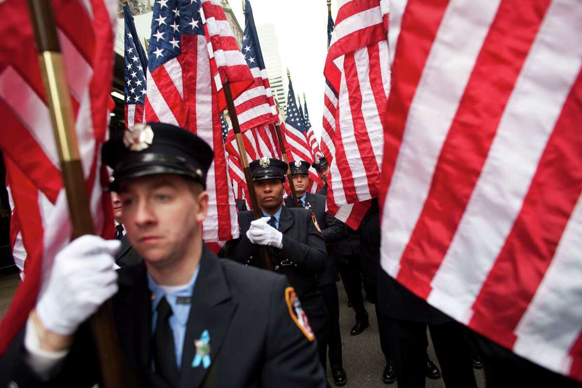 NEW YORK, NY - MARCH 16: Members of FDNY march on Fifth Avenue during the 252nd annual St. Patrick's Day Parade March 16, 2013 in New York City. The parade honors the patron saint of Ireland and was held for the first time in New York on March 17, 1762, 14 years before the signing of the Declaration of Independence.