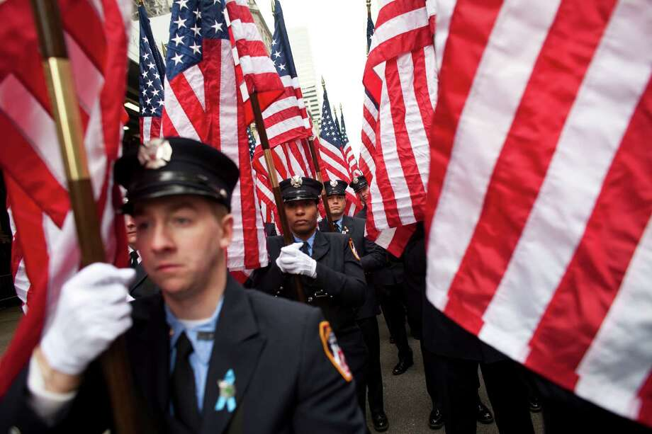 NEW YORK, NY - MARCH 16: Members of FDNY march on Fifth Avenue during the 252nd annual St. Patrick's Day Parade March 16, 2013 in New York City. The parade honors the patron saint of Ireland and was held for the first time in New York on March 17, 1762, 14 years before the signing of the Declaration of Independence. Photo: Ramin Talaie, Getty Images / 2013 Getty Images