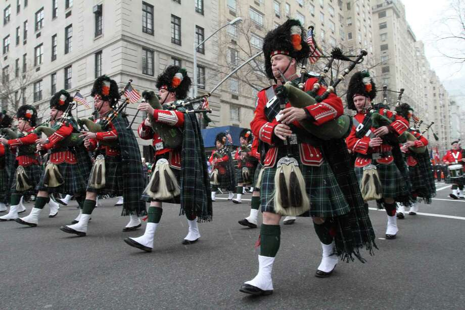 Members of the New York City Fire Department's Emerald Society Pipes and Drums make their way up New York's Fifth Avenue as they take part in the St. Patrick's Day Parade Saturday March 16, 2013. Photo: Tina Fineberg, AP / FR73987 AP