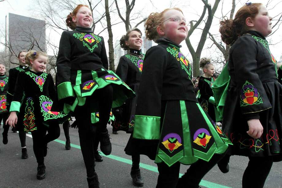 Members of the Emerald Isle Step Dancers, from Wilkes-Barre, Pennsylvania,  make their way up New York's Fifth Avenue as they take part in the St. Patrick's Day Parade Saturday,  March 16, 2013. Photo: Tina Fineberg, AP / FR73987 AP
