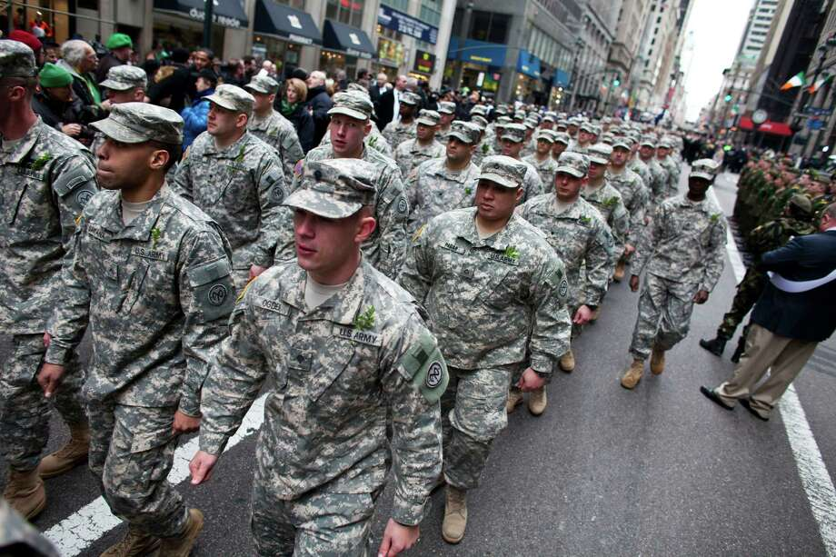NEW YORK, NY - MARCH 16: Members of the New York State National Guards march on Fifth Avenue during the 252nd annual St. Patrick's Day Parade March 16, 2013 in New York City. The parade honors the patron saint of Ireland and was held for the first time in New York on March 17, 1762, 14 years before the signing of the Declaration of Independence. Photo: Ramin Talaie, Getty Images / 2013 Getty Images