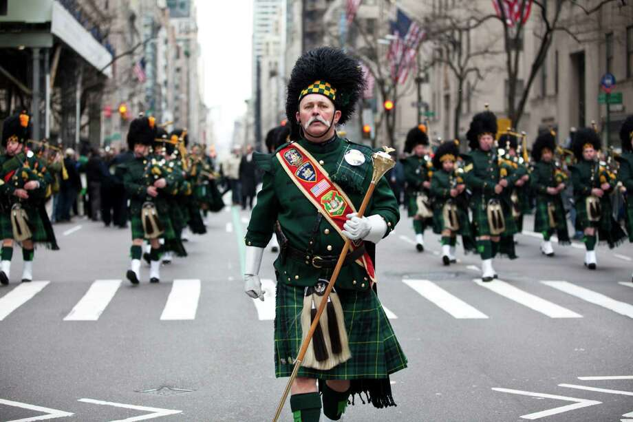 NEW YORK, NY - MARCH 16: A pipes and drums band marches on Fifth Avenue during the 252nd annual St. Patrick's Day Parade March 16, 2013 in New York City. The parade honors the patron saint of Ireland and was held for the first time in New York on March 17, 1762, 14 years before the signing of the Declaration of Independence. Photo: Ramin Talaie, Getty Images / 2013 Getty Images