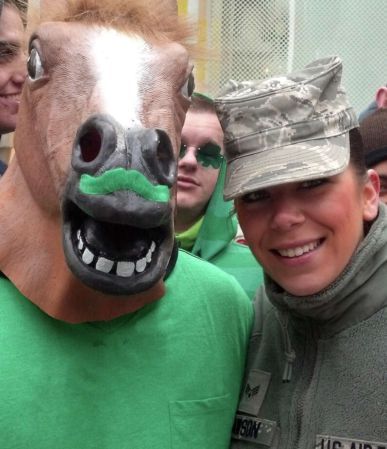 Paramus, N.J. resident, James Dawson, 18, celebrates his Irish heritage wearing a horse's head with a green mustache, during the St. Patrickís Day Parade on New York Cityís Fifth Avenue, Saturday, March 16, 2013. At right is Dawson's sister, 23 year old Lauren Dawson. Photo: Verena Dobnik, AP / AP