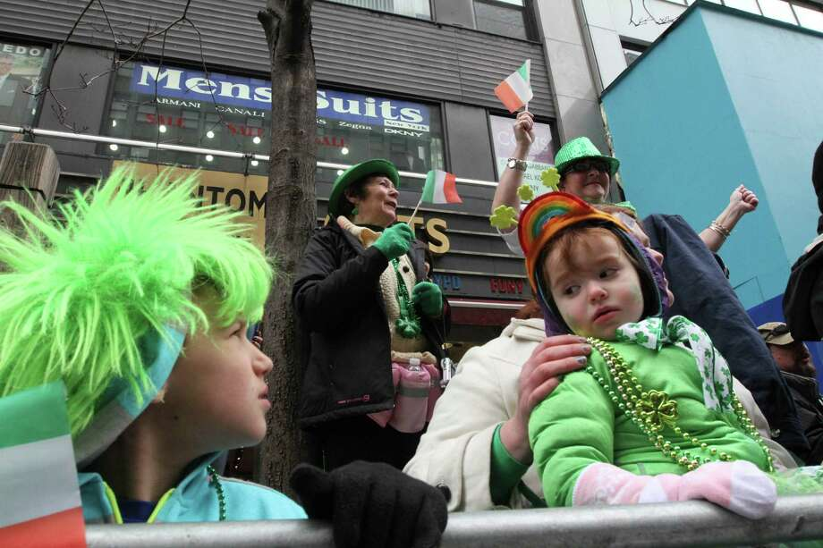 Young spectators watch the St. Patrick's Day Parade along New York's Fifth Avenue on Saturday March 16, 2013. Photo: Tina Fineberg, AP / FR73987 AP