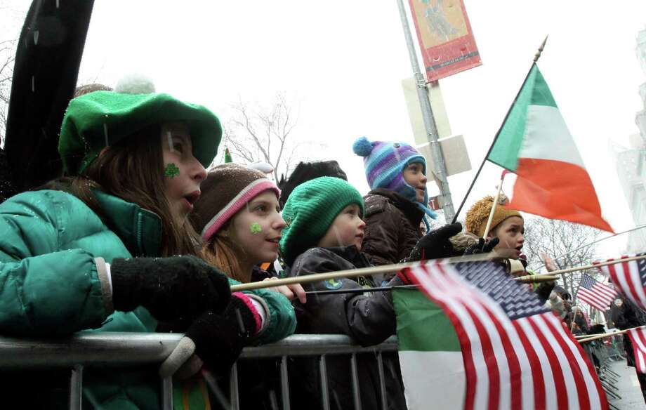 Anna Kearns, 11, of Yonkers, N.Y,. left, and other young spectators watch the St. Patrick's Day Parade on New York's Fifth Avenue, Saturday March 16, 2013. Photo: Tina Fineberg, AP / FR73987 AP