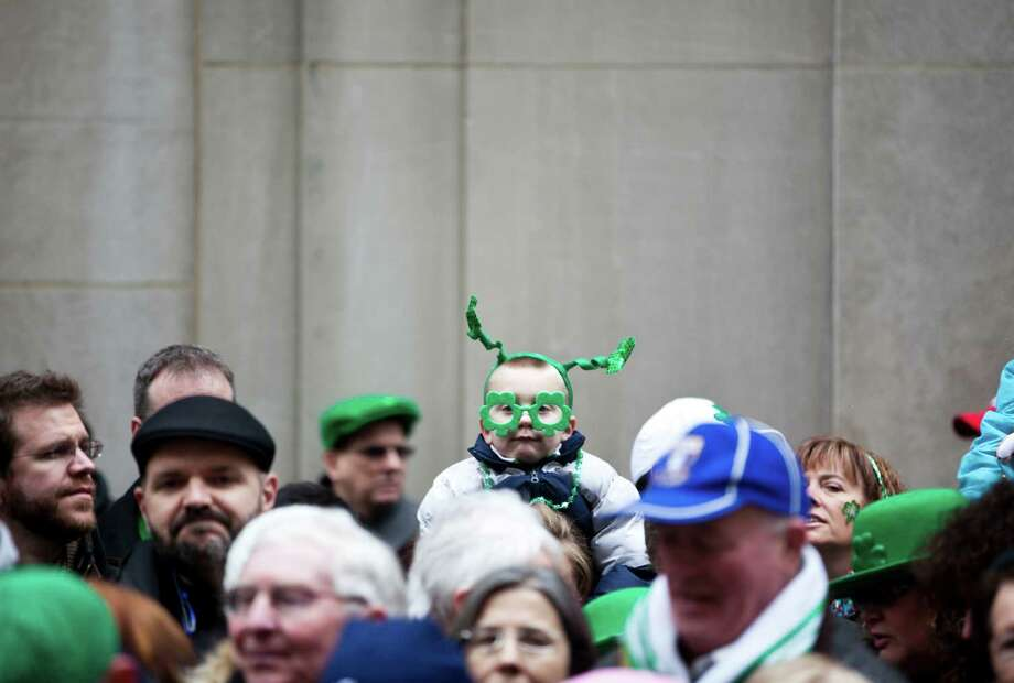 NEW YORK, NY - MARCH 16: Revelers watch the 252nd annual St. Patrick's Day Parade March 16, 2013 in New York City. The parade honors the patron saint of Ireland and was held for the first time in New York on March 17, 1762, 14 years before the signing of the Declaration of Independence. Photo: Ramin Talaie, Getty Images / 2013 Getty Images
