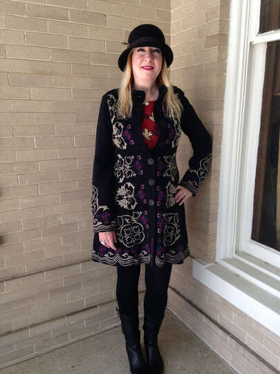 Carol Chapman-Ryan rocks a bohemian look with a multi-hued Russian-inspired embroidered coat