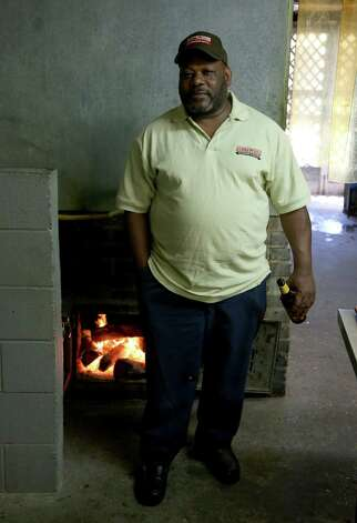 The personable son of Roy and Willie Burns, this pitmaster says the secret to great barbecue is patience. The proof is in his brisket, which is smoked using three types of post oak. The homemade beef-and-pork sausage is a fan favorite, too. Photo: Thomas B. Shea, For The Chronicle / © 2013 Thomas B. Shea
