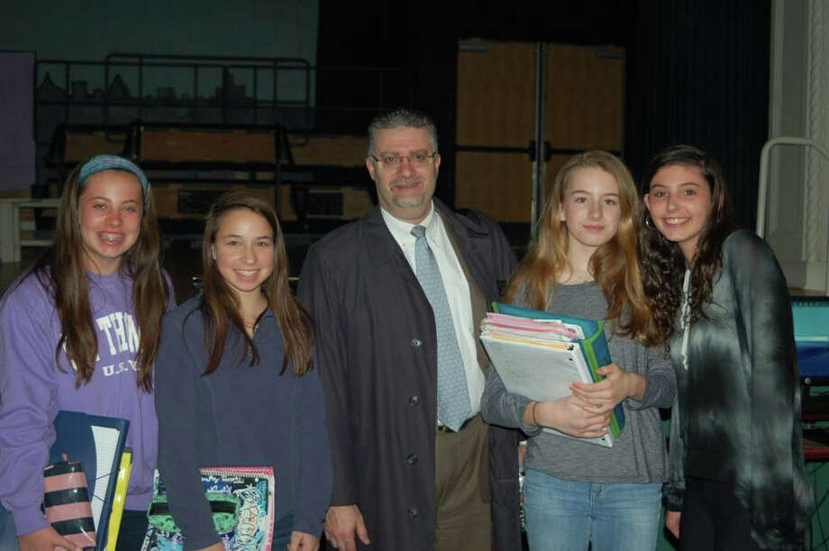 Middlesex Middle School eighth-grade students, from left, Addison Stauffer, Madeline Kauffman, Helena Nicholls and Grace Feingold met with Connecticut senior assistant state's attorney Richard Colangelo, center, after his presentation on cyber bullying. Photo: Contributed