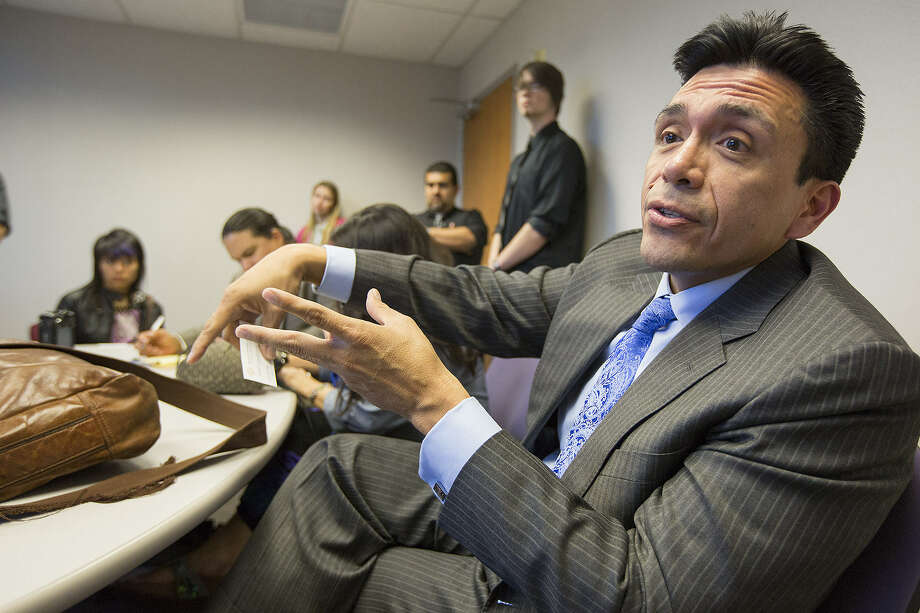 Tony Diaz, a Houston-based author and political activist, speaks during a meeting at the State Capitol earlier this month. Diaz is part of the Librotraficante movement, which went to Austin to protest a bill they say will wipe out ethnic studies programs. Photo: Express-News File Photo