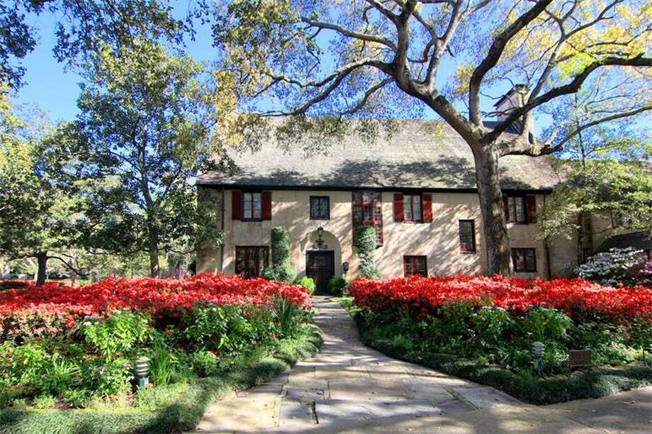 This picturesque cottage features four bedrooms and five bedrooms. It also comes with a beautiful rose and flower garden, a wine closet and a third-floor game room. Photo: John Daugherty Realtors
