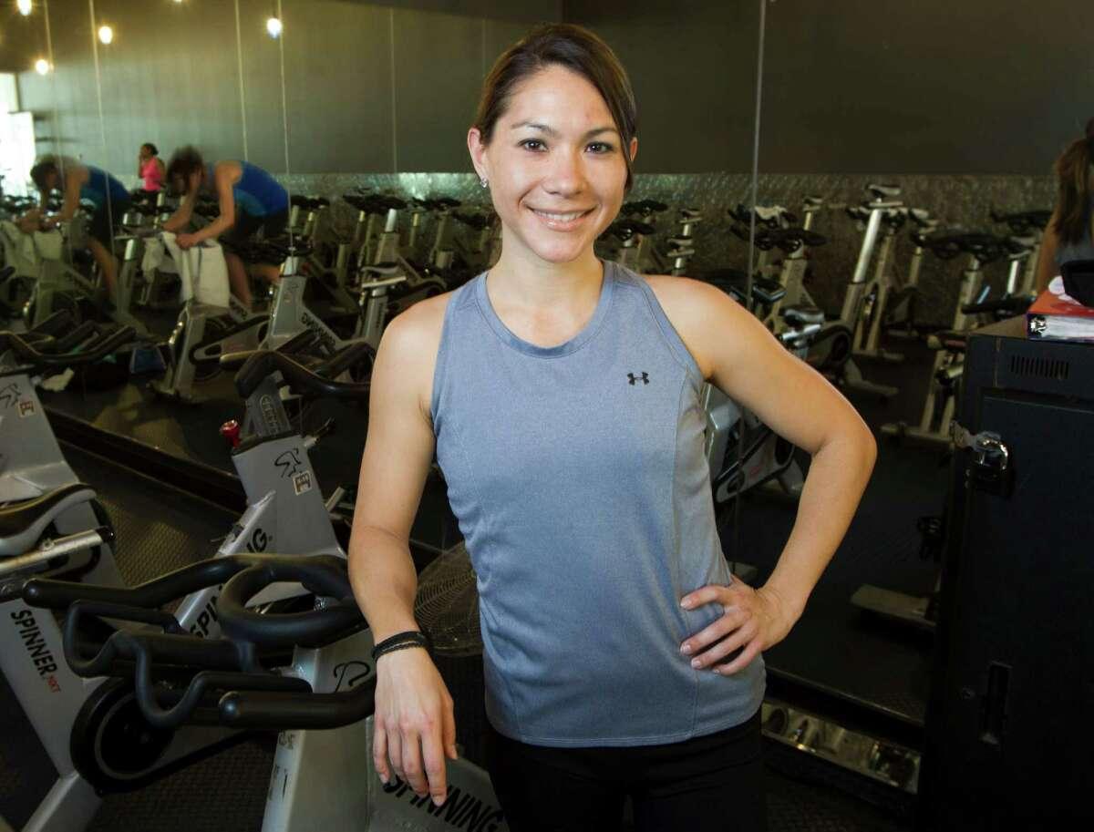 Spin instructor Cassandra Smisson poses for a portrait at 24 Hour Fitness Super Sport Thursday, March 7, 2013, in Houston. ( Brett Coomer / Houston Chronicle )