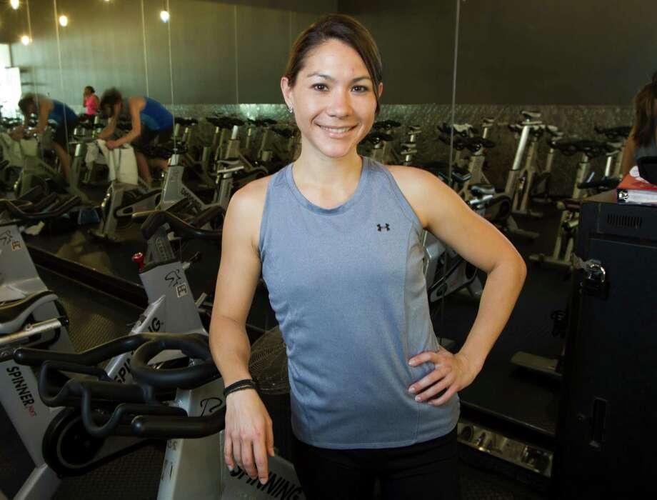 Spin instructor Cassandra Smisson poses for a portrait at 24 Hour Fitness Super Sport Thursday, March 7, 2013, in Houston. ( Brett Coomer / Houston Chronicle ) Photo: Brett Coomer, Staff / © 2013 Houston Chronicle
