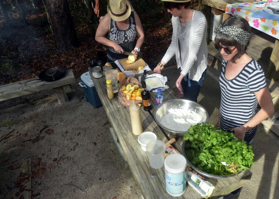 Chef Monica Cobb (left), Celine Hodge and Adrienne Ryherd help prepare food at Slow Food Beaumont's Oysterfest at Village Creek State Park in Lumberton. Beth Rankin/cat5 Photo: Beth Rankin / Beth Rankin