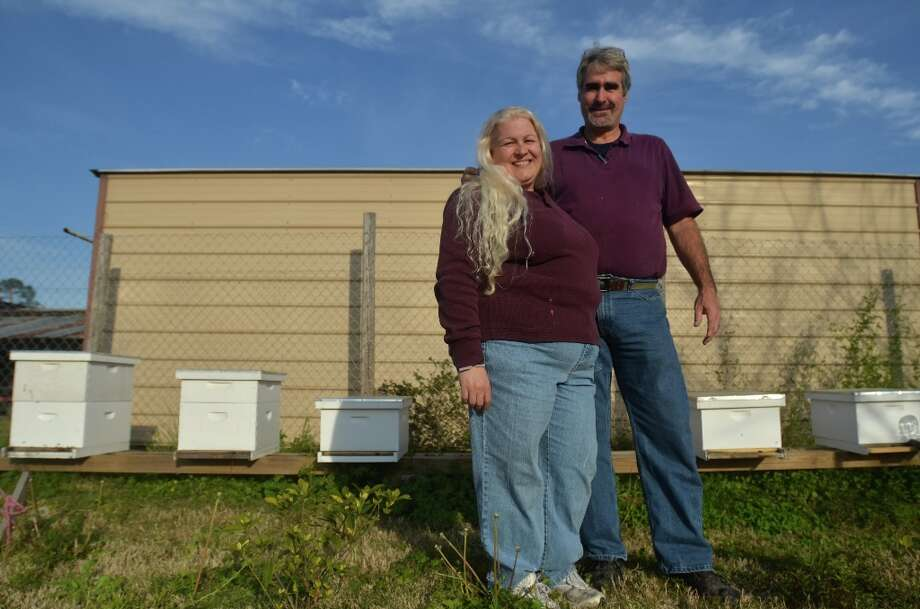 Tammy and Brian Muldrow stand in front of several of their hives at Muldrow Bee Farm in Beaumont. The couple rescues bee hives and allows them to recover before harvesting honey. Beth Rankin/cat5 Photo: Beth Rankin / Beth Rankin