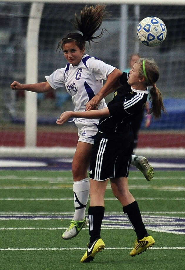 PN-G player Hannah Higgins, #6, plays the ball off her head during the Port Neches- Groves District 38-4A championship girls soccer game against Nederland on Tuesday, March 19, 2013, at PN-G High School. Photo taken: Randy Edwards/The Enterprise Photo: Randy Edwards