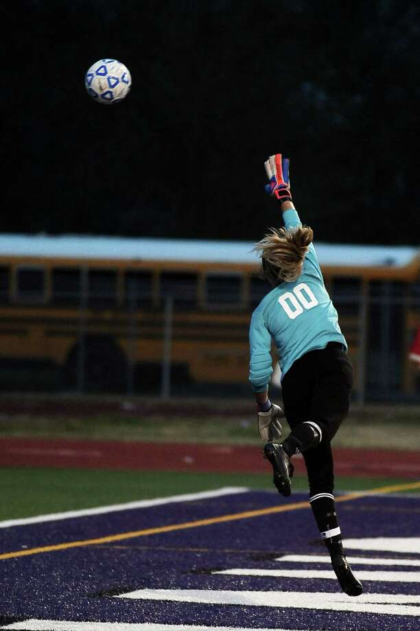 PN-G goalie Lauren Lovejoy lets the ball  past her on a goal by Felicia Sauceda during the Port Neches- Groves District 38-4A championship girls soccer game against Nederland on Tuesday, March 19, 2013, at PN-G High School. Photo taken: Randy Edwards/The Enterprise Photo: Randy Edwards