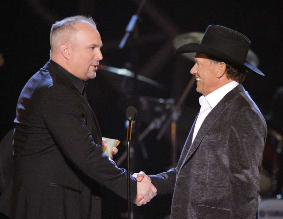 Garth Brooks (left) presents George Strait with the ACM Artist of the Decade award in 2009. The two  stars will perform together  at the Academy of Country Music Awards on April 7. Photo: Associated Press