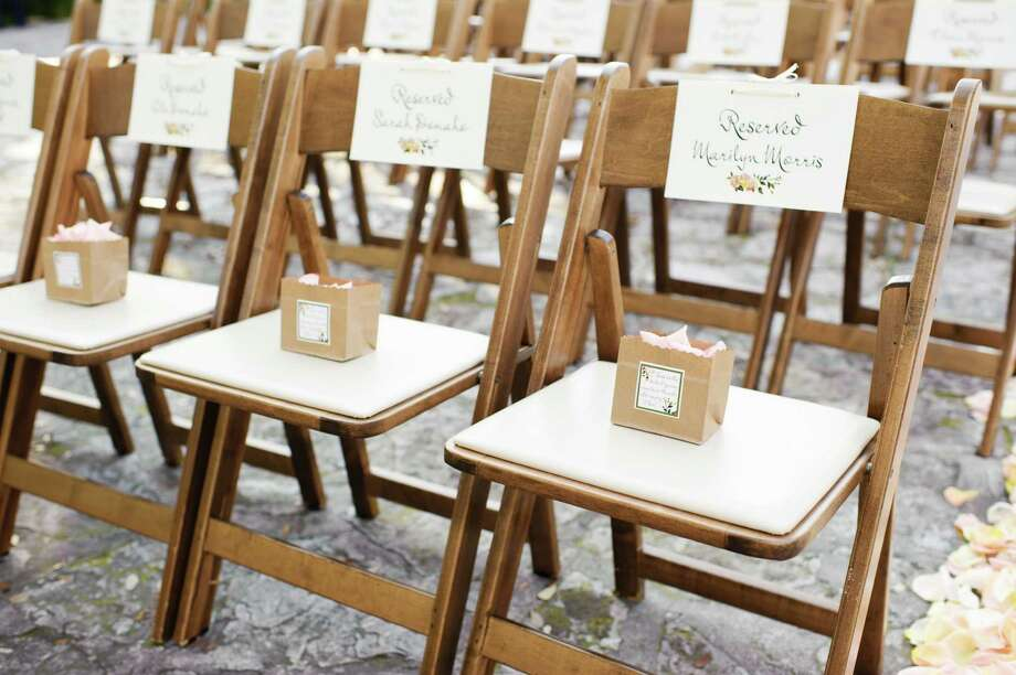 Printed materials at the wedding become part of the decorations. It's an informative and cost-effective way to decorate, says event coordinator Tracy French. Photo: Courtesy Perez Photography