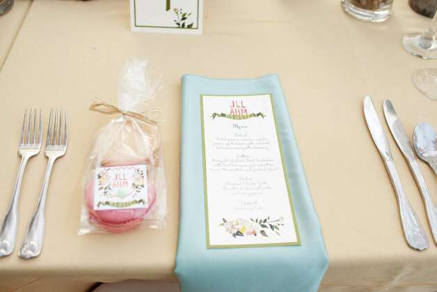 Even the menu can become part of the décor at receptions. It's an informative and cost-effective way to decorate, says event coordinator Tracy French. Photo: Courtesy Perez Photography