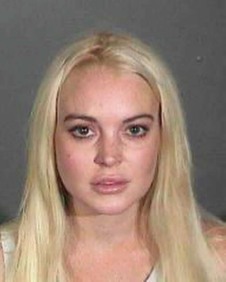 In this booking photo provided by the Los Angeles County Sheriffs Department Actress Lindsay Lohan is shown after she was taken into custody, Wednesday, Oct. 19, 2011. The actress was taken into custody after Superior Court Judge Stephanie Sautner revoked her probation because she was ousted from a community service assignment at a women's shelter. Photo: AP / ONLINE_CHECK