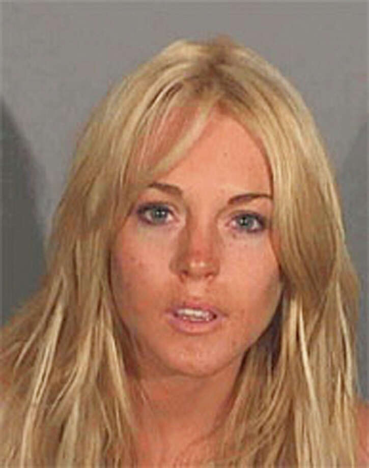 2007: Lindsay Lohan, seen here in a booking mug released by the Santa Monica Police Department, Santa Monica, Calif., Tuesday, July 24, 2007, was arrested on suspicion of drunken driving early Tuesday, authorities said. Photo: Ho, AP / ONLINE_YES