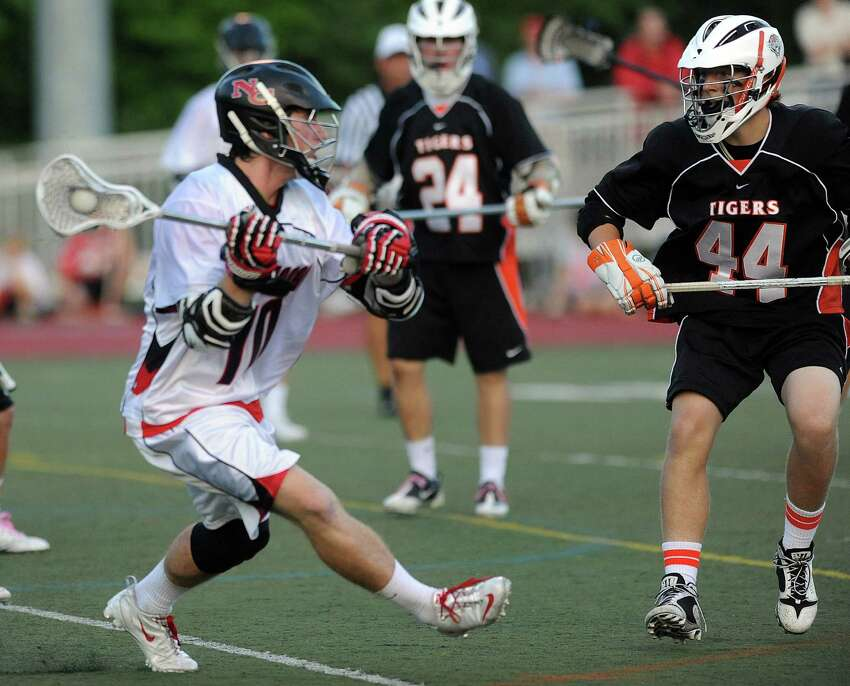 New Canaan's Peter Kraus controls the ball during Friday's FCIAC boys lacrosse championship game at Brien McMahon High School in Norwalk on May 25, 2012.