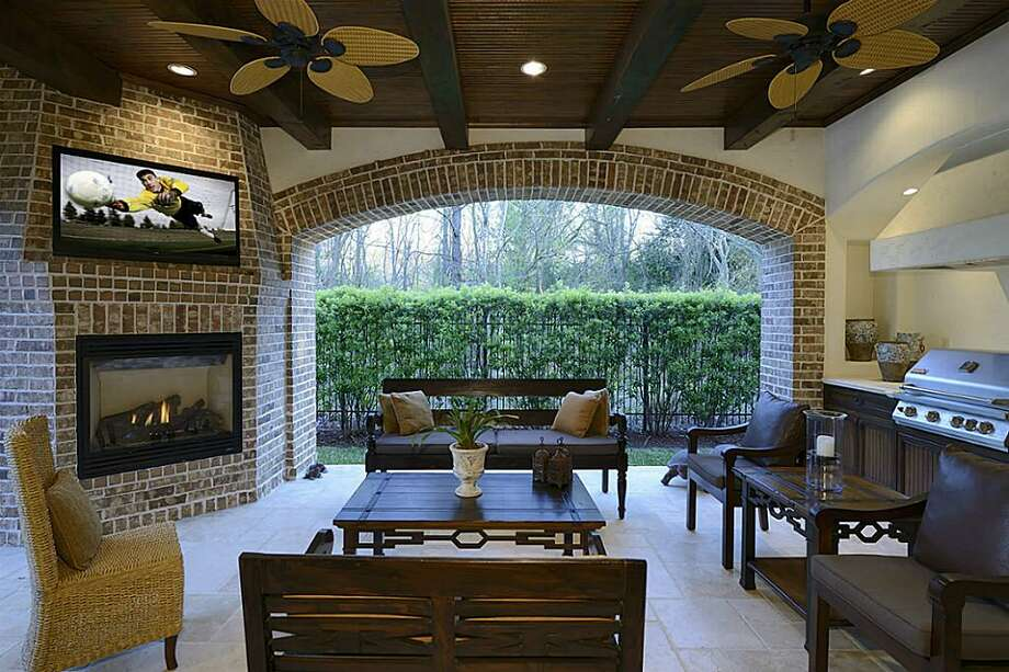 The Spanish-style villa offers plenty of amenities, including a gorgeous pool and outdoor sitting area. The home features five bedrooms and five bathrooms on more than 8,700 square feet.Tour the rest of Houston's open homes. Photo: Greenwood King Properties
