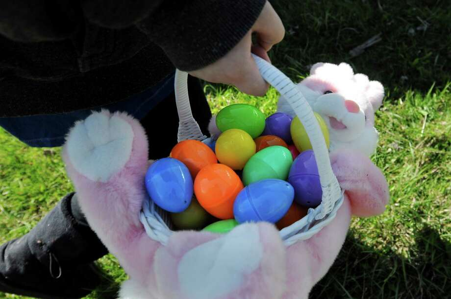 A youngster carries a stuffed bunny basket filled with booty from an Easter egg hunt on Saturday, April 7, 2012, at St. John's Episcopal Church in Cohoes, N.Y.  (Cindy Schultz / Times Union) Photo: Cindy Schultz / 00017087A