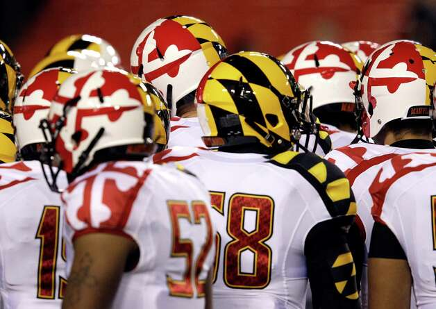 Last year, Maryland unleashed these suckers on the world. One advantage: Like zebras, it is hard to distinguish one player from another in the huddle. Photo: Patrick Semansky, Associated Press / AP