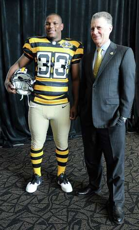 Pittsburgh Steelers running back Isaac Redman models the team's 2012 throwbacks ... to a bumble bee penitentiary? Photo: Christopher Horner, Associated Press / Pittsburgh Tribune-Review