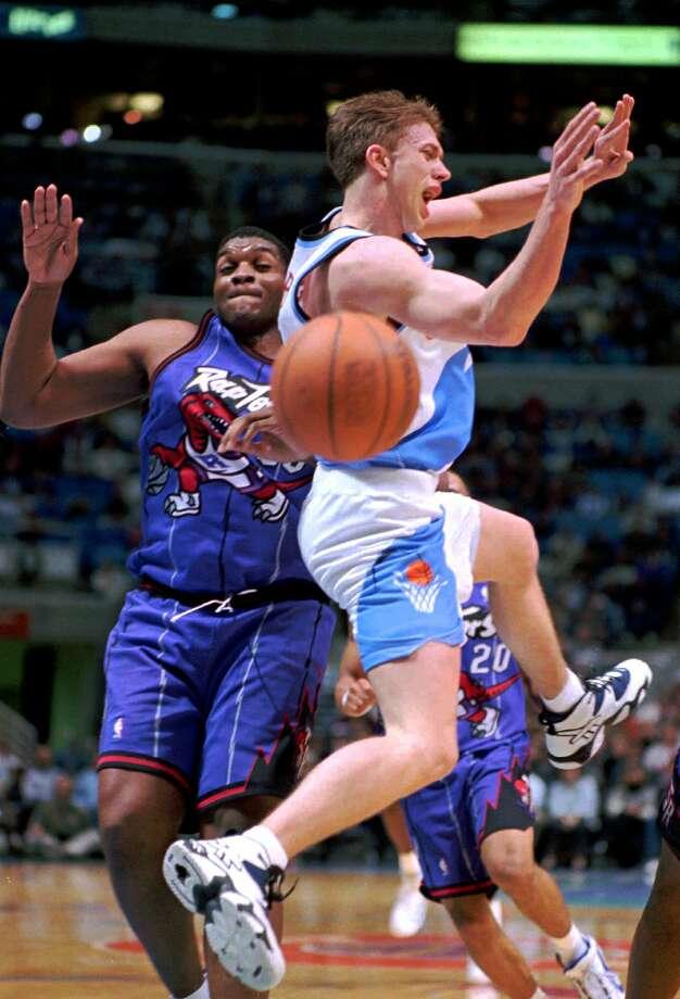 Nothing says basketball like a ballin' Raptor on purple striped pajamas. Photo: MARK DUNCAN, Associated Press / AP