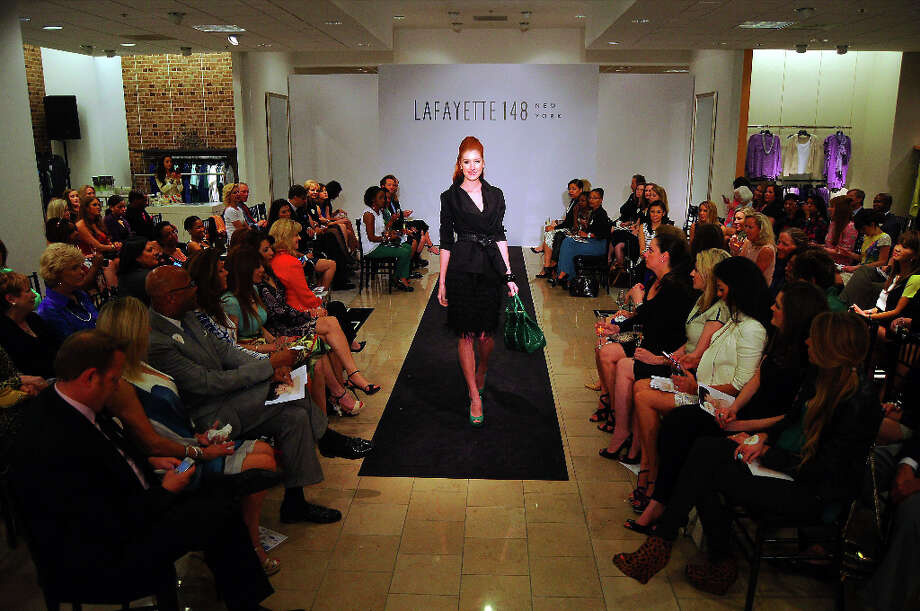 A model walks the runway Photo: Dave Rossman, For The Houston Chronicle / © 2013 Dave Rossman