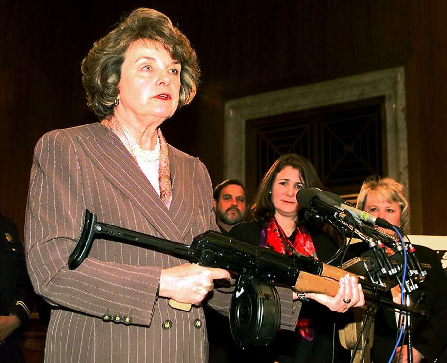 Sen. Dianne Feinstein holds an AK-47 automatic rifle during a 1999 news conference in Washington about gun control. Photo: Denniis Cook