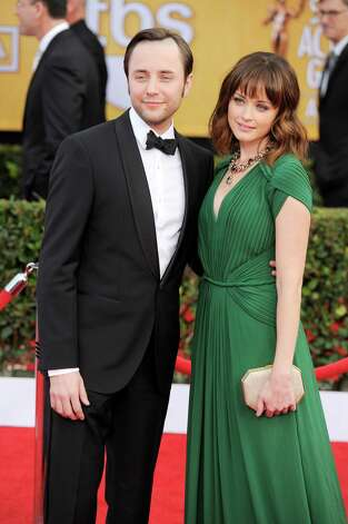 "FILE - This Jan. 27, 2013 file photo shows actors Vincent Kartheiser, left, and Alexis Bledel at the 19th Annual Screen Actors Guild Awards at the Shrine Auditorium in Los Angeles. Bledel's publicist, Meghan Prophet, is confirming the news that the couple is engaged. The 33-year-old Kartheiser plays ad man Pete Campbell on the hit AMC network drama ""Mad Men,"" and Bledel, 31, is best known for her role as the teenage daughter in the long-running series ""Gilmore Girls."" (Photo by Chris Pizzello/Invision/AP, file) Photo: Chris Pizzello"