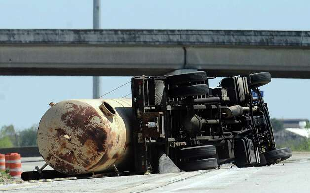 A tanker truck carrying diesel over turned just before the Downtown exit heading East on Interstate-10 on Wednesday, March 20, 2013.   Photo taken: Randy Edwards/The Enterprise