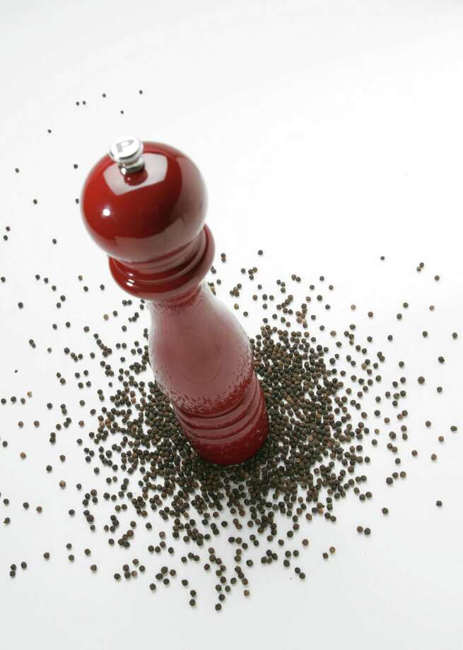 Peppercorns come in a variety of colors, and each spices and flavors food in its own way. (Glenn Koenig/Los Angeles Times/MCT) Photo: Glenn Koenig / Los Angeles Times
