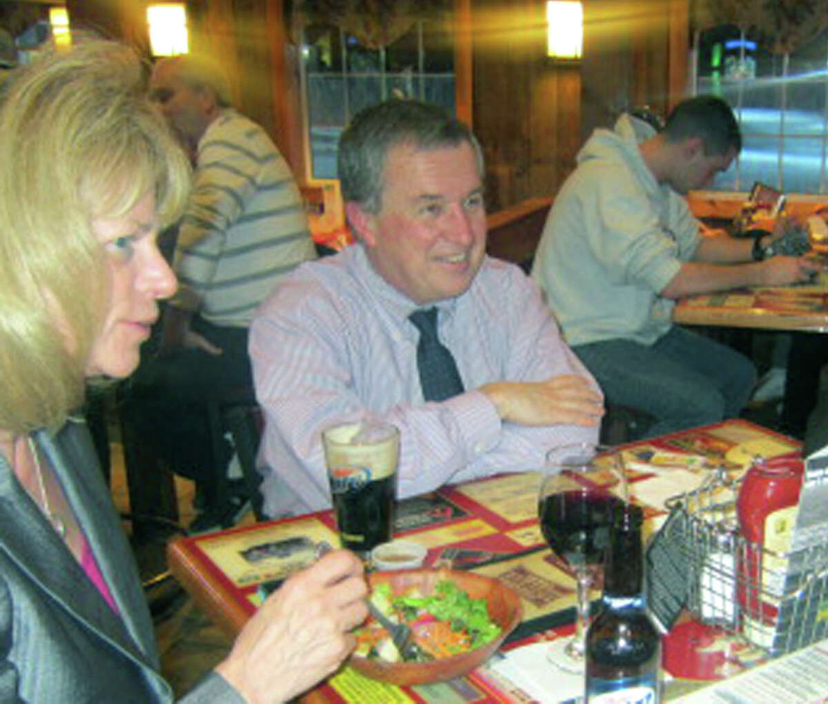 Kevin Dumas, a charter board member and longtime treasurer for MVP-SOS, enjoys dinner with his wife, Diana, during The Cookhouse's Feb. 27, 2013 fundraiser for the local charitable organization.