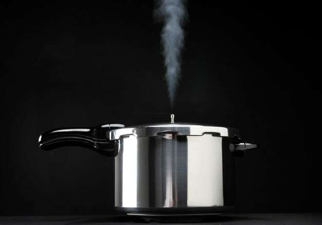 Pressure cooker with steam, Monday March 4, 2013, in Colonie, N.Y. (Will Waldron/Times Union) Photo: Will Waldron
