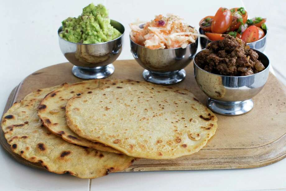 In this image taken on March 4, 2013, tortillas with tomato-mint salsa and guacamole are shown in Concord, N.H. (AP Photo/Matthew Mead) Photo: MATTHEW MEAD