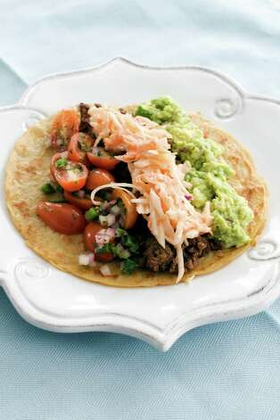 In this image taken on March 4, 2013, tortillas with tomato-mint salsa and guacamole are shown served on a plate in Concord, N.H. (AP Photo/Matthew Mead) Photo: Matthew Mead