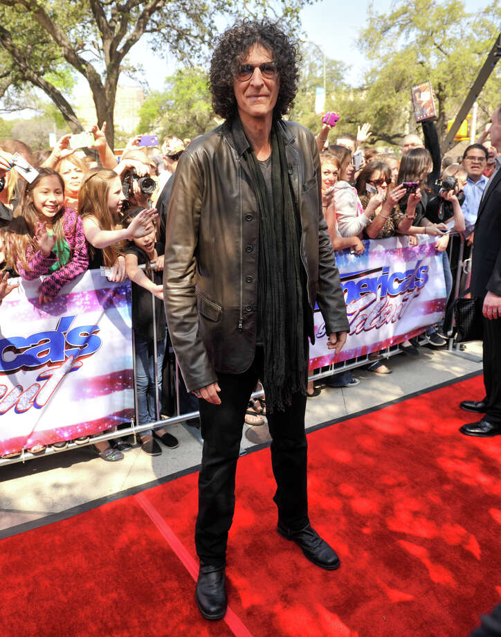Howard Stern poses for photographers as he arrives on the red carpet in front of the Lila Cockrell Theater for a taping of the television show America's Got Talent Wednesday. Photo: Robin Jerstad