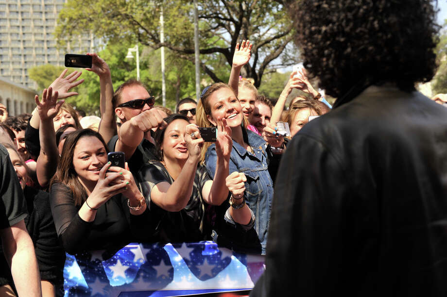 Fans cheers Howard Stern as he arrives on the red carpet in front of the Lila Cockrell Theater for a taping of the television show America's Got Talent Wednesday. Photo: Robin Jerstad