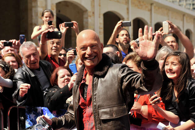 Howie Mandel waves as he arrives on the red carpet in front of the Lila Cockrell Theater for a taping of the television show America's Got Talent Wednesday. Photo: Robin Jerstad