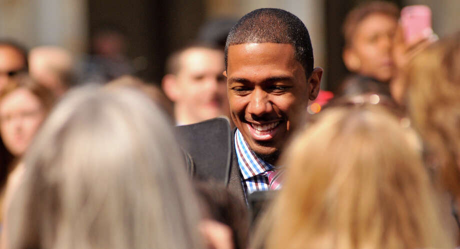 Nick Cannon talks with fans as he arrives on the red carpet in front of the Lila Cockrell Theater for a taping of the television show America's Got Talent Wednesday. Photo: Robin Jerstad